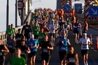 Marathon competitors crossing the Auckland Harbour Bridge were refreshed by a cooling breeze. Photo / Getty Images