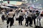 Indonesia police clash with workers of mining giant Freeport-McMoran during a protest in Timika. Photo / AP