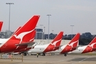 The tails of Qantas planes are lined up at Sydney Airport in Sydney, Sunday, October 30, 2011. Photo / AP
