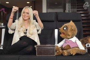 Lindsay Lohan and Air NZ mascot Rico find plenty of space to get to know each other on the Skycouch. Photo / Supplied