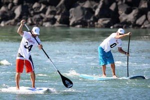 Haydn Smith, JP Tobin and Jeremy Stephenson demonstrate stand up paddle boarding. Photo / Natalie Slade