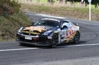 Tony Quinn and Naomi Tillett (Nissan GT-R35)  defended their 2010 Targa New Zealand title with another impressive overall win in this year's event. Photo / Ground-Sky