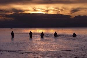 Trout fishermen on Lake Taupo. Photo / Alan Gibson