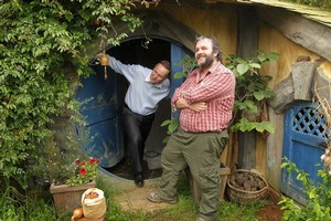 Prime Minister John Key is shown the interior of a 'hobbit house' by director Sir Peter Jackson, during a recent visit to the set of the 'The Hobbit'. Photo / Alan Gibson