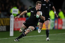 Richie McCaw in action. Photo / Brett Phibbs