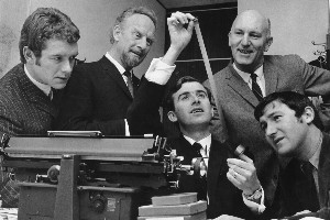 Maurice Smyth, the producer (centre), examines some film while Rhys Jones, Keith Bracey, Lindsay Broberg and Tom Finlayson look on during preparation for an edition of Town and Around. Photo / NZ Herald archives