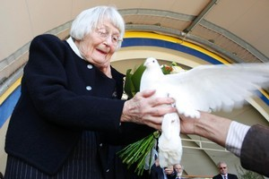 Jean Hubbard releasing a dove in memory of her husband Allan Hubbard, who died in a car crash in September, at the Memorial Service for in Timaru last month. Photo / SNPA / Pam Johnson
