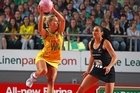 Erin Bell of the Diamonds receives a pass with Joelene Henry of the Silver Ferns defending. Photo / Getty Images
