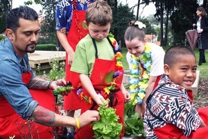 Michael Meredith (left) visiting his local school's garden. Photo / Supplied