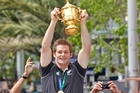 Richie McCaw lifts the Rugby World Cup. Photo / Steven McNicholl
