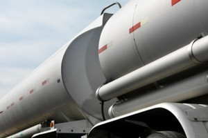 The collision between a car and petrol tanker has left one person trapped. Photo / Thinkstock