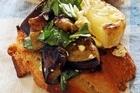 Grilled eggplant with basil, lemon and feta bruschetta. Photo / Janna Dixon