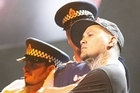 Tiki Taane performs with dancers dressed as police at the New Zealand Music Awards. Photo / Richard Robinson