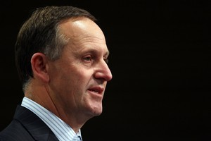 John Key plans to use asset sales to help get New Zealand out of debt. Photo / Getty Images