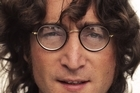 John Lennon's rotten tooth has sold at auction. Photo / Supplied