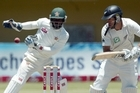 New Zealand's captain Ross Taylor (R) in action as Zimbabwe's wicket keeper Regis Chakabva looks on. Photo / AFP
