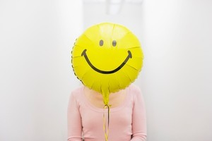 Putting a smile on your dial will wipe years off your age, according to a new study. Photo / File