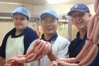 NZ Farm Co's Bryce Gyde, Michael Cao (Smallgoods Manager) and Stephen Holyer (general manager). Photo / Supplied