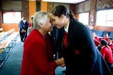 Hato Petera College deputy head prefect Chenay Dadley (right) greets Tariana Turia yesterday. Photo / Dean Purcell