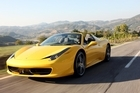 The Ferrari 458 Spider has a fully retractable aluminium roof that folds flat in 14 seconds. Photo / Supplied