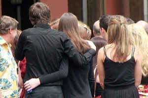 Friends and family comfort each other at Christie's memorial service. Photo / Doug Sherring
