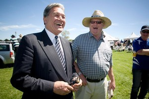 New Zealand First party leader Winston Peters shares a laugh with Grant Adams at the Dargaville races. Photo / Natalie Slade