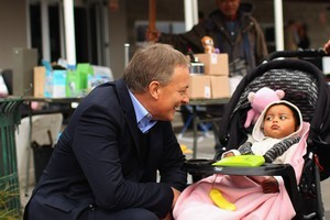 Labour Leader Phil Goff on a meet and greet at the Wesley Market in September. Under the party's child policy paid parental leave would be extended to 6 months. Photo / Getty images