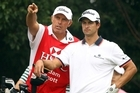 Australian golfer Adam Scott (right) is sticking with his New Zealand caddie Steve Williams. Photo / AP