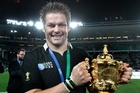 Despite a damaged and painful right foot, Richie McCaw was at the core of the Webb Ellis Cup victory. Photo / Brett Phibbs