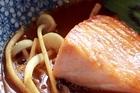 Baked salmon in an Asian broth. Photo / Doug Sherring