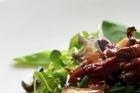Shaved paua on a watercress salad. Photo / Doug Sherring
