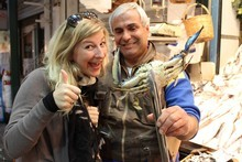 Charlotte with a seafood vendor at Thessaloniki's Modiano Market. Photo / Mauricio Olmedo-Perez
