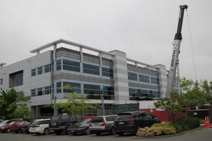 """The Statistics NZ building in Madras Street which is being re-levelled with new """"screw piles"""". Photo / Amanda Cropp"""