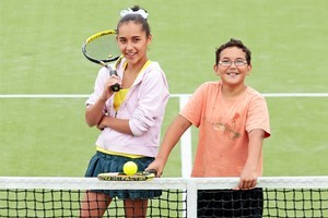 Siblings, twelve-year-old Elise and nine-year-old Noah Brown, playing tennis at the Pt Chev Tennis Club. Photo / Richard Robinson