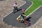 Daniel and Nicholas Jones learn to ride bikes at the learn-to-ride cycle path a the the Onepoto Domain in Northcote. Photo / Steven McNicholl