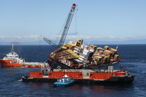 The container retrieval vessel SeaTow 60 being positioned next to Rena yesterday. Photo / supplied