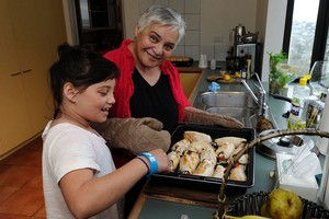 Tariana Turia helps granddaughter Piata prepare dinner. Photo / Anthony Phelps