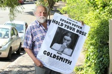 Artist Peter Lange with one of the posters he has printed urging Epsom voters to cast their vote for National's Paul Goldsmith in an attempt to counter National's tacit endorsement of Act candidate John Banks. Photo / Paul Estcourt