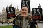 Campaigners for change of media regulation, with one in a puppet of James Murdoch, Chief executive of News Corporation Europe and Asia, protest outside the Houses of Parliament in London. Photo / AP