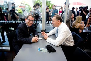 National Party leader John Key and Act Party member John Banks at a cafe in Newmarket during a cup of tea meeting. A recording device can be seen on the table. Photo / Dean Purcell.