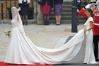 Pippa Middleton holds her sister Catherine's dress at this year's royal wedding. Photo / AP