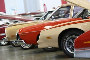 Muscle cars for sale at Turners Auctions. GPG sold off its investments in numerous companies over the past year as it winds down and returns capital to investors. Photo / Michael Cunningham