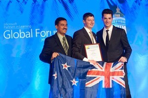 Chris Clay, centre, receiving his award from (l) Anthony Salcito - Vice President, Education Microsoft and Kapil Wadhera, General Manager, Intel. Photo / Supplied