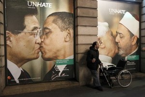A Benetton store window covered by posters as part of the launch of a campaign with photo montages showing the pope Benedict XVI kissing an imam on the lips and Barack Obama smooching his Chinese counterpart Hu Jintao. Photo / AFP