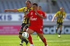 Cassio of Adelaide United (R) is tackled by Lee Bertos of the Wellington Phoenix (L). Photo / Getty Images