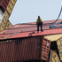 Salvors pictured standing on fallen shipping containers onboard the Rena. Photo / Alan Gibson