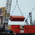 A shipping container is lifted off the Rena. Photo / Alan Gibson