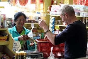 Tarulata Patelat Mahadeo's gives Grant Allen his spices. Photo / Janna Dixon