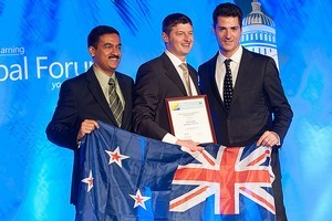 Chris Clay receives his award from Anthony Salcito - Vice President, Education Microsoft and Kapil Wadhera, General Manager, Intel. Photo / Supplied