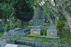 Piles of old headstones, thought to be from the Kioreroa Cemetery, have been uncovered by recent erosion along the Onerahi foreshore. Photo / Thinkstock